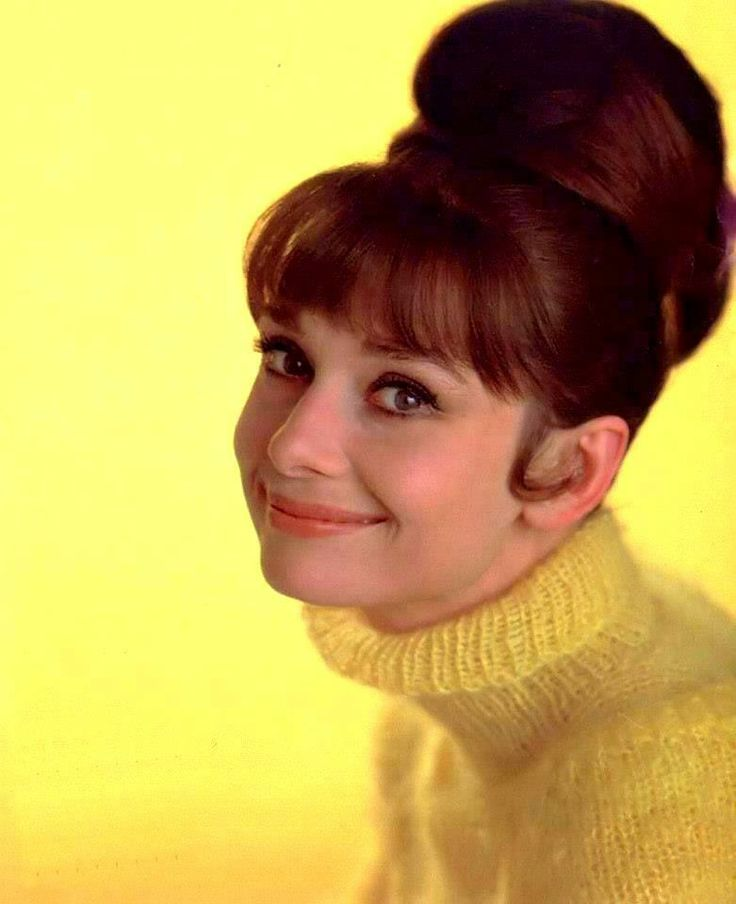 °audrey° Audrey Hepburn wearing a yellow tricot sweater by Balmain, New York, June 1963. Photo by Howell Conant.