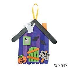Craft Stick Haunted House with Halloween craft foam stickers.