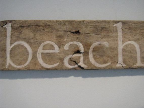 driftwood sign  at the beach.calm