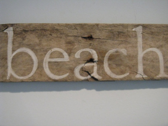 driftwood sign  at the beach.calm