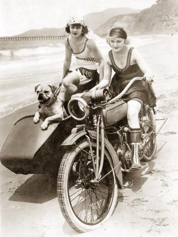 Girls and a motorcycle with a sidecar from the 1920's....and cute dog!