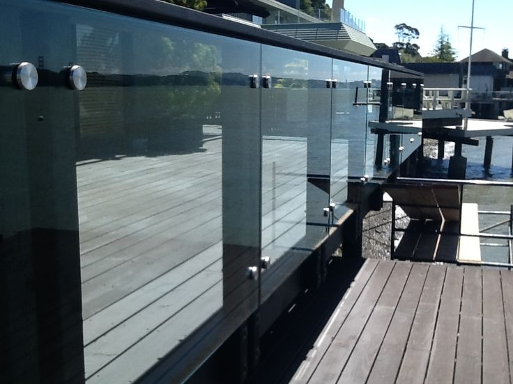 """Close Up View of a Deck Railing with 2"""" Diameter #316 Stainless Steel Standoffs"""