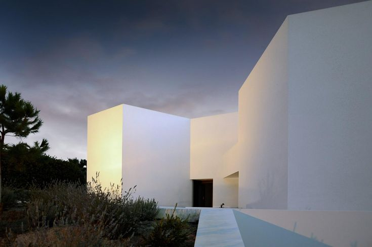 Sugarcubes is a minimalist house located in Tróia, Portugal, designed by Montenegro Architects Ltd.
