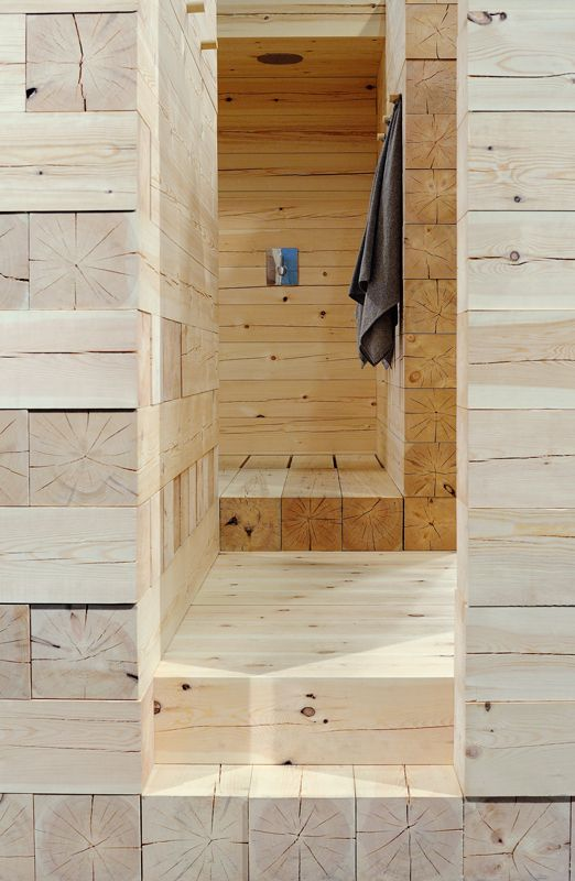 Sauna designed by Avanto Architects from Helsinki Finland. It is built by simply laying massive logs over each other on a plot five by six meters.