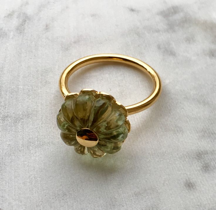 18 carat gold ring with carved green amethyst