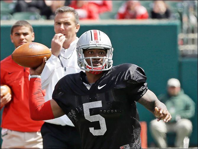 Braxton Miller passes during Ohio State's spring game under the watch of coach Urban Meyer.