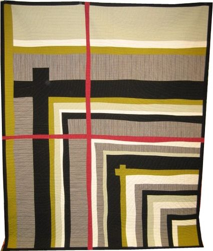 The quilt was made than sliced and the red was inserted.  Wonderful result.