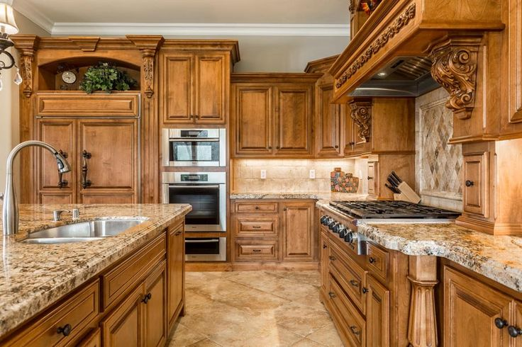 Alderwood custom cabinets by Frank Jordan of Roseville, CA. Chef's kitchen with high-end appliances including sub-zero refrigerator. Custom luxury home along the country roads in Lincoln, CA. Mediterranean style on 10 rolling  acres. Lots of oak trees, barn, and a pond.