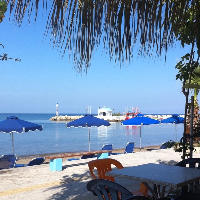 Faliraki's lido beach. In the distance is the chapel of aghious apostolous. This is what you see when you step on the beach from our bay view studios :)