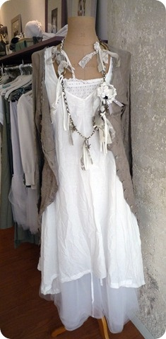 Simple gauzy white dress paired with ultra-feminine neclace and a light neutral sweater.  Pretty <3
