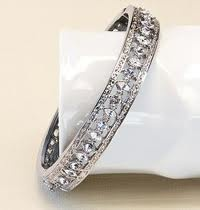 John Kennedy presented Jacqueline Jackie with this lovely bangle bracelet as a special second gift upon their engagement. The original bracelet was purchased from Van Cleef and Arpels on Fifth Avenue in New York. Mrs. Kennedy wore the bracelet frequently throughout her life, eventually bequeathing the beloved piece to her daughter, Caroline.