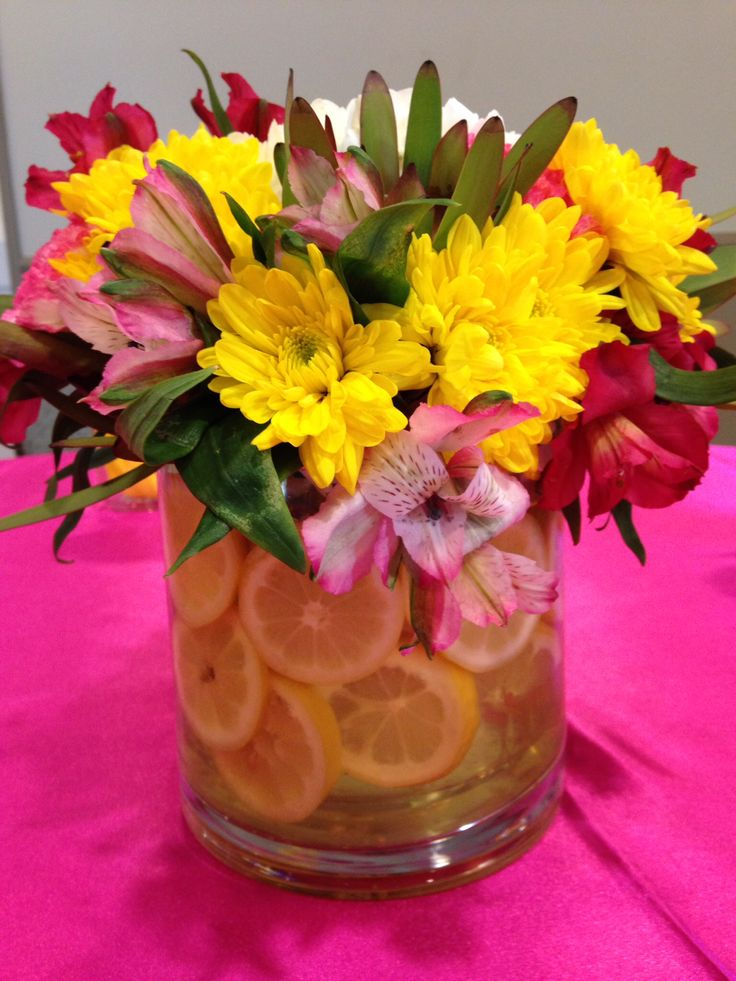 Lemon centerpieces. Pink and yellow.
