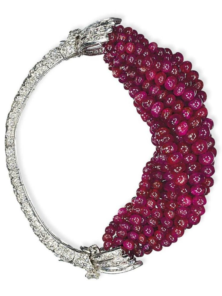 CARTIER - AN ART DECO RUBY AND DIAMOND BRACELET, CIRCA 1930. The front section designed as twelve strands of graduated ruby beads, to the pavé-set diamond half-hoop and shoulders, with French assay mark for gold, signed Cartier Paris, and numbered. #Cartier #ArtDeco #bracelet
