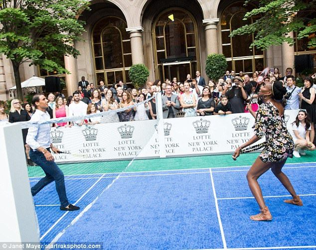 The crowd cheered as they watched the two stars of the tennis world do battle