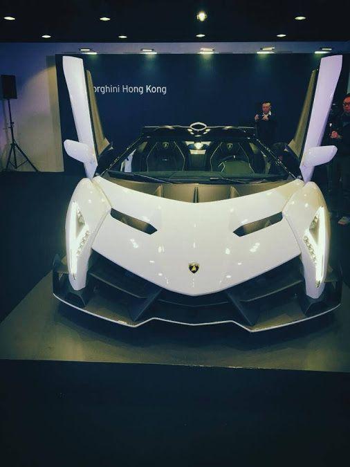 White Lamborghini Veneno Roadster Front View Doors Up;