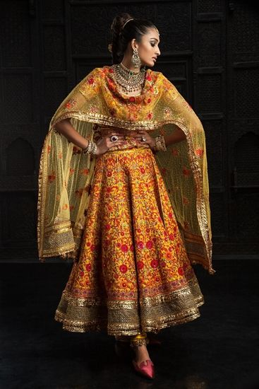 Pre-draped, pre-constructed garments dominate Tahiliani's couture line.