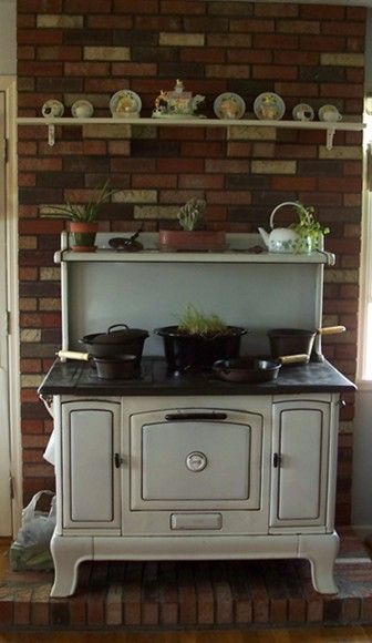 Wood Cookstove - looks a lot like ours! We will be using it outside this year, but it will be in the remodeled kitchen for everyday use... yay us!