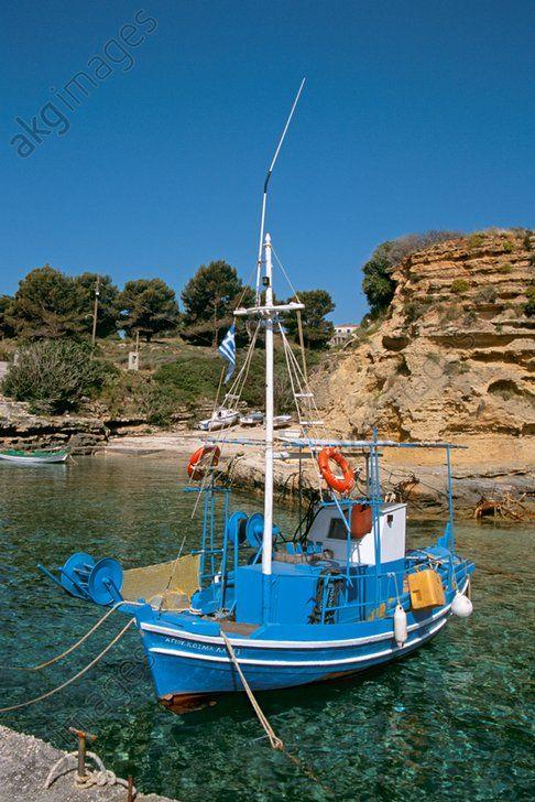 Old blue fishing boat moored in Pessada harbour, Pessada, Kefalonia, Greece
