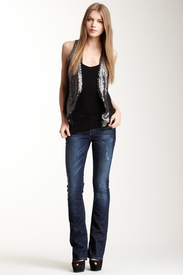 Love this look-black camisole, blue jeans with heels, and silver vest.