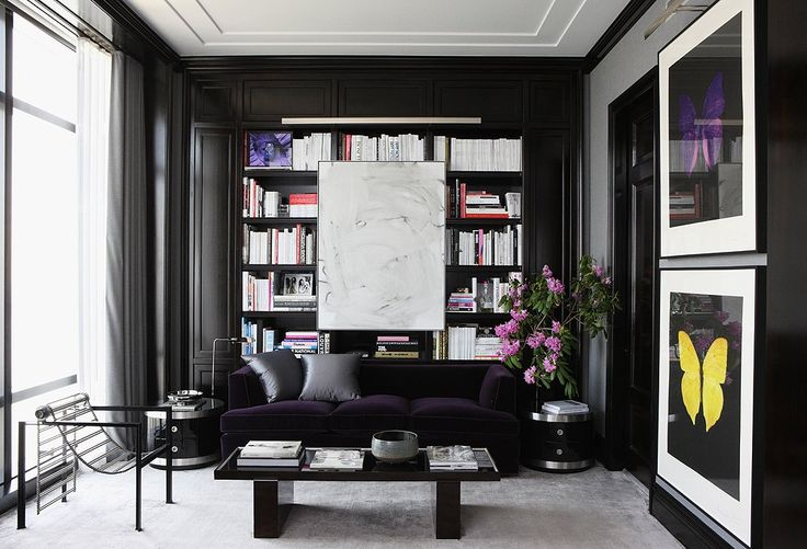 While a black library can read masculine, you can counterbalance it by subtly working in more-feminine hues like pale pink or deep purple and luxe textures like velvet, satin, and faux fur.