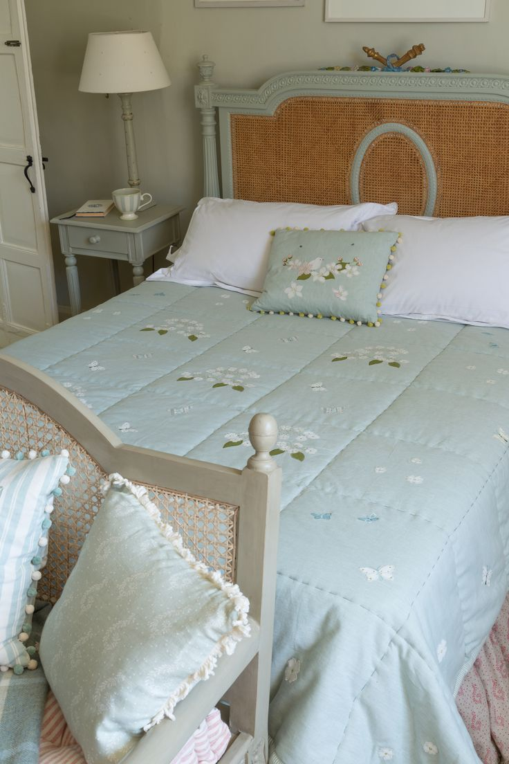 Use a gorgeous Duck Egg Hydrangea quilt to perfectly suit the wood of your handmade Cane/Wood Bed