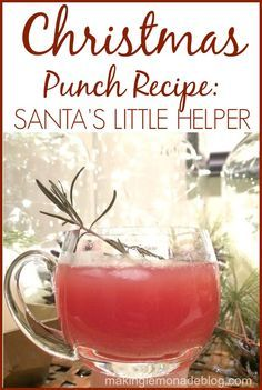 The BEST Christmas Punch Recipe: Santa's Little Helper! Your guests will love sipping this delicious punch over the holidays, and the recipe is so easy. Plus it looks perfectly festive. Enjoy!