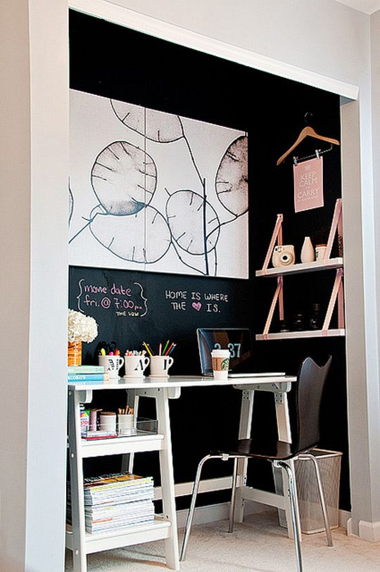 Closet offices from the blog A Cup of Mai. By removing the closet doors, giving the walls a few coats of chalkboard paint, and adding some floating shelves, she's created a clean, minimal, and cozy space that seems perfect for getting work done. via apartment therapy