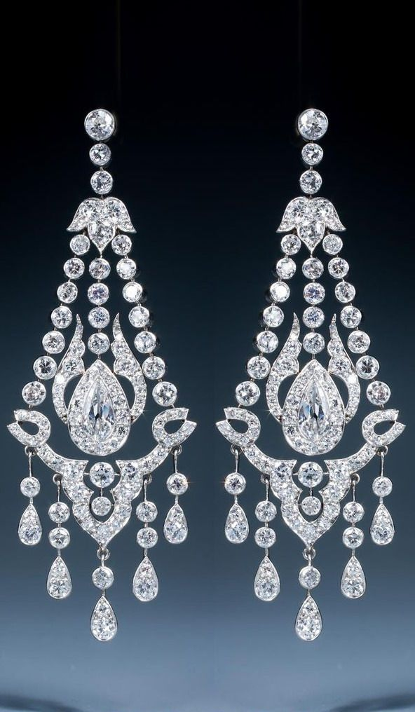 A magnificent early 20th century pair of diamond chandelier earrings, circa 1920.