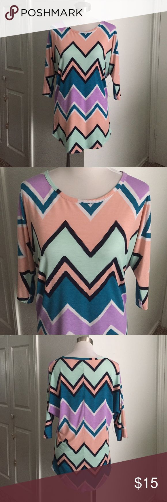 Slouchy Chevron Top Slouchy Chevron top. Slightly piko-style. Very loose and comfortable. Boutique brand. Great for work! Tops