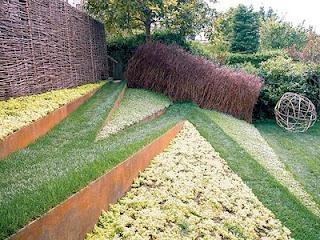 Andrea Cochran's children's garden [that's a slide under that willow tunnel!]