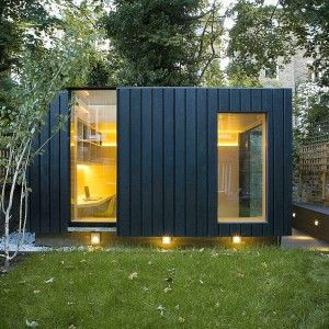 Garden room by Neil Dusheiko features walls of charred cedar - made using traditional japanese technique shou sufi ban - making them resistant to rot and fire