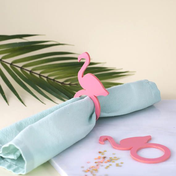 Add a tropical vibe to your party table with these fabulous flamingo napkin rings. These perspex napkin rings are made from laser cut 3mm perspex and are available in coral pink & sparkly gold. Napkin rings sold in pairs. Dimensions: 10cm H x 6cm W Ring Diameter 3.5cm These would add sparkle & delight to any party, wedding or gathering! If you require different quantities get in touch as this is something we can do for you.