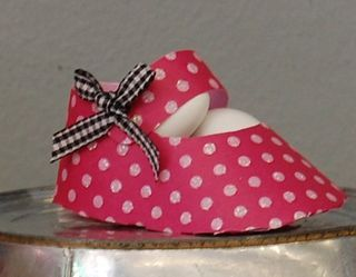 Designing & Motherhood: Heartland Paper baby shower paper booties filled with candy!