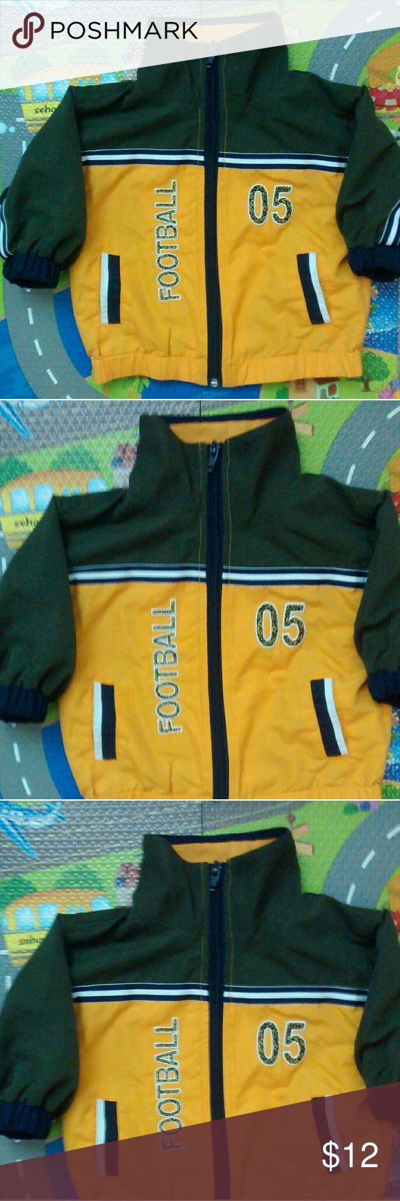 Football Jacket Fall zippered Football Jacket in army green, gold and dark blue in great condition with cotton lining, embroidered lettering and outlined graphics  size 6-9 months no brand listed on tag Jackets & Coats