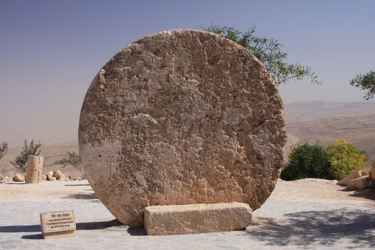 Jordan- the top of the mount Nebo. Rolling stone used as a  door a bizante monastery in the old village