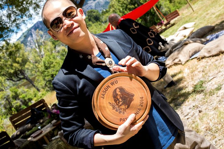 It's typical in Argentina to take a wooden plate to the asado pit and select a cut of meat. For the occasion, we customized plates with our guests' names, alongside the logo I designed with Darth Vader and my favorite flower of the area, the lupino. (The flower represents me; Mr. Vader, Alex.) Here's Jason Wu with his!