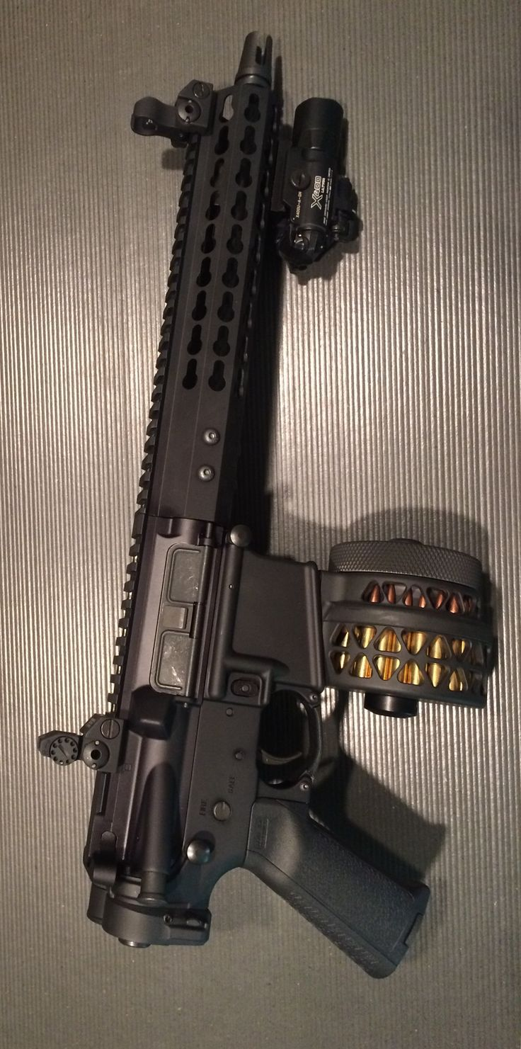 Palmetto State Armory AR Pistol 10.5in, Troy micro HK tritium sights, Thordsen Customs buffer tube cover, X Products X-15 50rd drum, Surefire X400U-G. Folded at 22in, rides secured in 5.11 cross shoulder, discreet bag with Savvy Sniper QD sling. The Black Hills 5.56 50gr Barnes TSX provide very reliable expansion at 50yds with the 10.5in barrel.