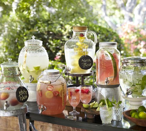 multiple style drink dispensers with chalk inscribed tags. stack on small cake stands and upside down planters to vary heights. love the look!