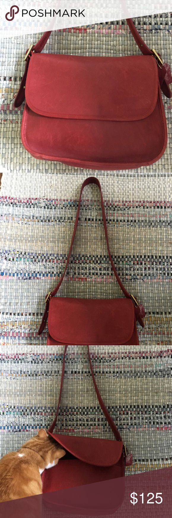 Vintage MADE IN USA red leather Coach Saddle Bag Buttery leather 1970/ vintage red coach saddle bag. Made in the USA. It has that delicious well-loved look with 1 large zipper pocket with two smaller pockets under the flap. Gold hardware with coach tag (tag is split- see picture) Coach Bags Crossbody Bags