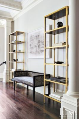 Sometimes all you need is a minimal bookcase and a lounge chair to create your home library. Simple and elegante