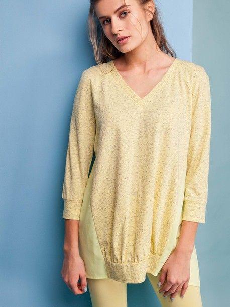 Delikatna i bardzo dziewczęca tunika w kolorze żółtym. Dostępna również miętowa. 3/4 rękawy. Dekolt w tak zwany 'serek'. Dziewczyny, co uważacie na temat tej bluzki?