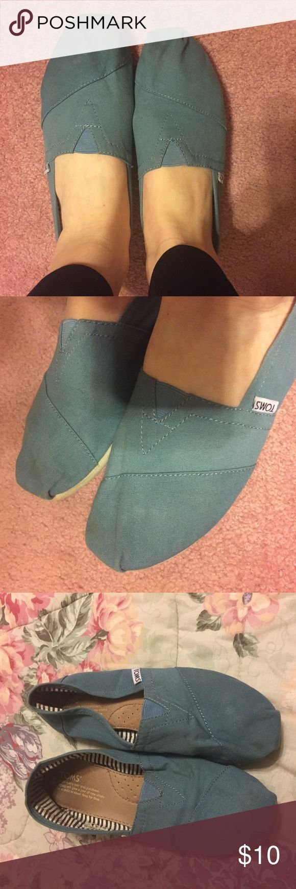 Blue toms Classic blue toms in good used condition. A little bent out of shape from storage but will puff back up with wear. Toms Shoes Flats & Loafers