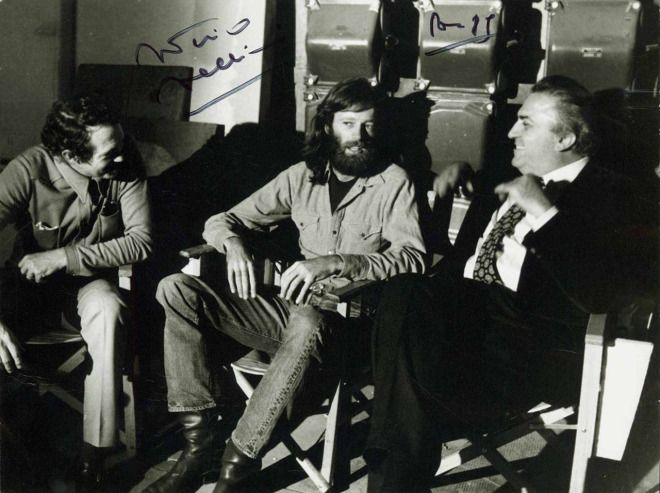 Fellini, Peter Fonda and Warren Oates on the set of the movie 'Roma' in Cinecittà shows.