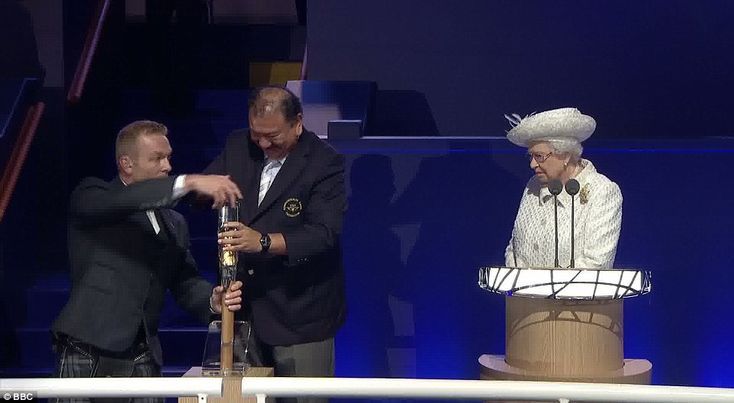 The Queen looked concerned as Sir Chris Hoy and Commonwealth Games Federation president Prince Imran from Malaysia struggled to get her message out of the baton, where it has been kept for more than 10 months