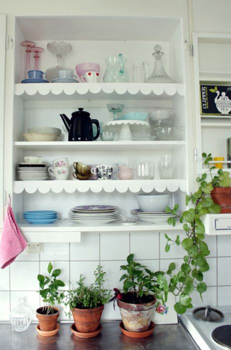 shelving with lovely colored antiques