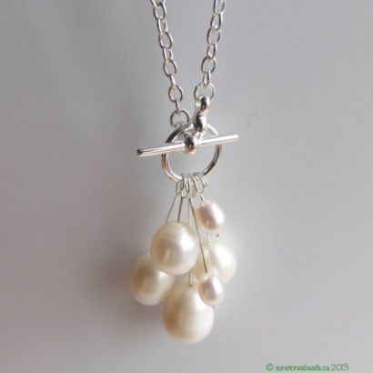 Simple pearl (or bead) pendant.. Do this with purple or green pearls and use the grape leaf toggle!