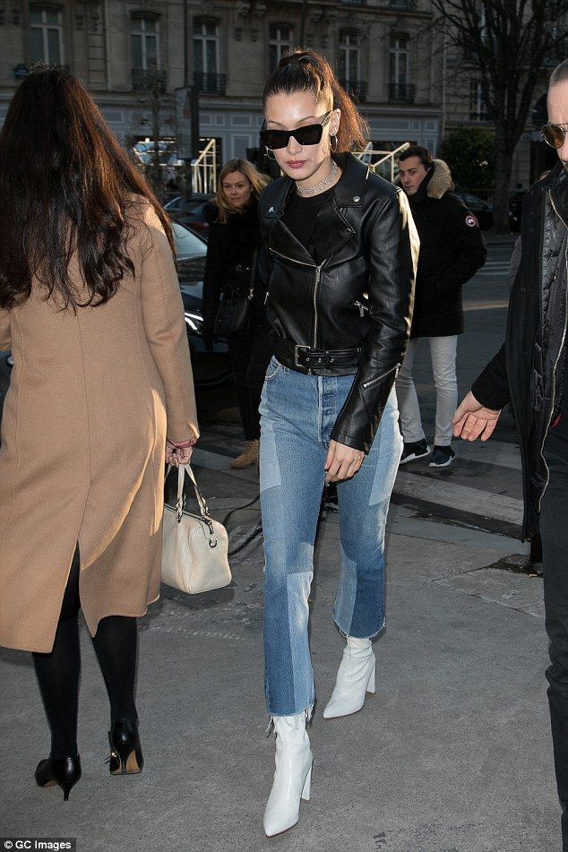Fashionista: Bella Hadid, 20, dressed to flatter her lithe frame in an edgy biker jacket and seventies-inspired patchwork jeans as she headed out in Paris on Saturday