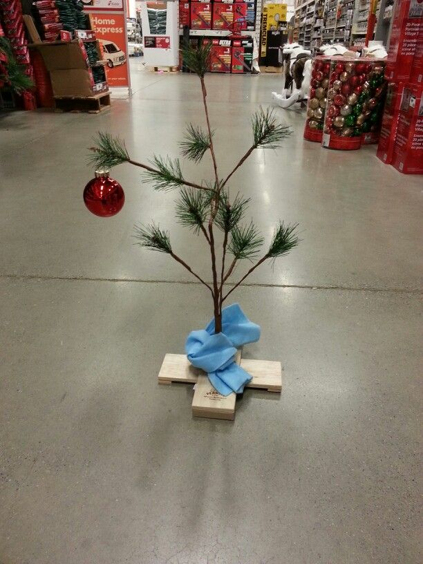 Charlie brown cChristmas tree, plays theme song too, I want it so bad