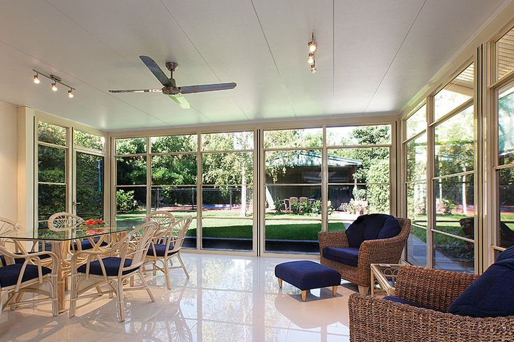 A beautiful Shademaster insulated roofing in a outdoor room.