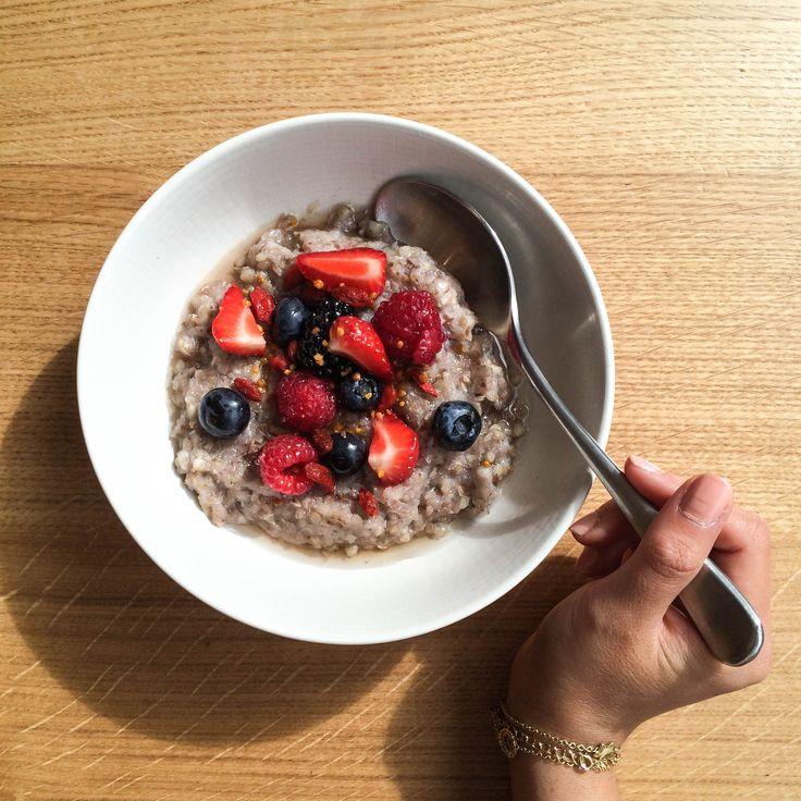 Coconut Buckwheat Porridge topped with raw honey, seasonal berries and bee pollen. Yum!